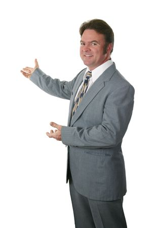 real leader: A realtor or businessman gesturing toward a new home or a chart.  Isolated. Stock Photo