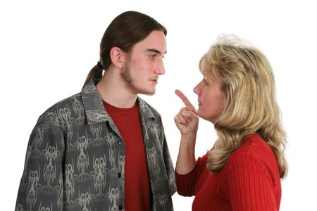 A beligerant teen boy confronts his mother. photo
