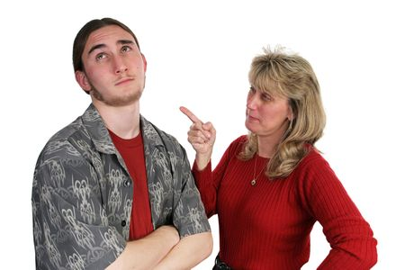 A mother scolding her teen son whos rolling his eyes and ignoring her (focus on mother) photo