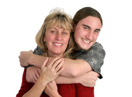 teenaged boy: A teenaged boy and his mother posing for a portrait. Stock Photo