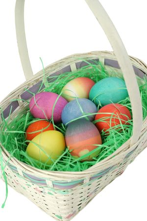 Colored easter eggs in a white basket. photo