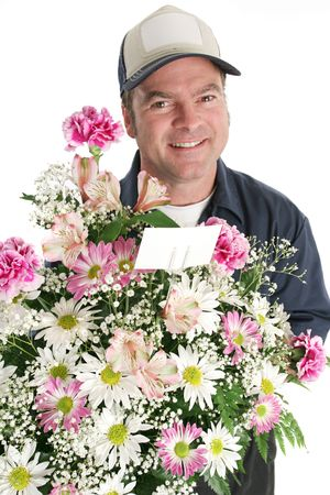 A bouquet of flowers being delivered. (focus on flowers and card) photo