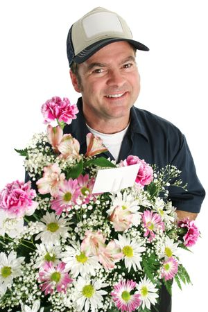 A man delivering flowers for a special occasion. photo