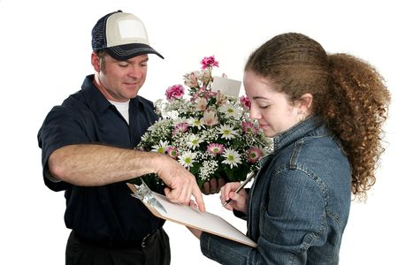 teenaged: A teenaged girl signing for a flower delivery.