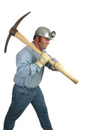 A coal miner using a pick ax in the mines. photo