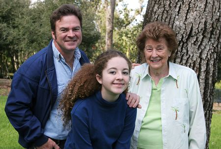 A father, daughter and grandmother at the park together. photo