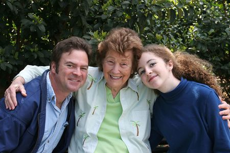 A mother, son and granddaughter enjoying time together in the park. photo