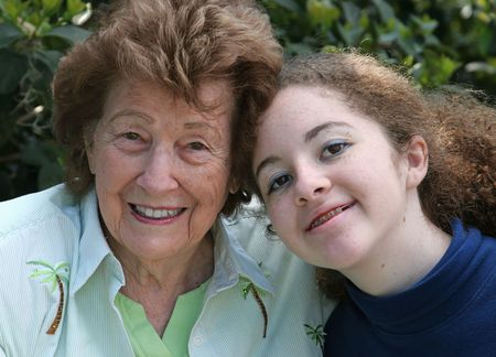 A closeup portrait of a sweet grandmother and cute teen granddaughter. photo
