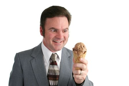 crazed: A businessman looking at an ice cream cone with a crazed look. Stock Photo