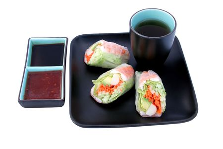 A Japanese salad roll served with tea, and chili & soy sauces for dipping.  Clipping paths included.