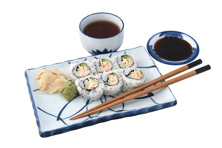 california roll: A california roll, tea and soy sauce on Japanese plate, isolated. Stock Photo