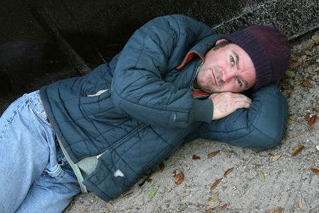 wino: A homeless man lying on the ground.
