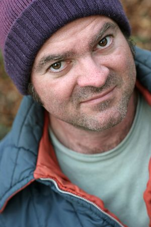 streetlife: A closup portrait of a homeless man.  Shallow depth of field, with focus on his left eye. Stock Photo