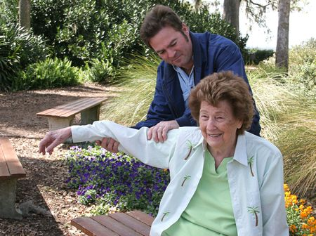 back rub: A senior woman receiving physical therapy in the garden.
