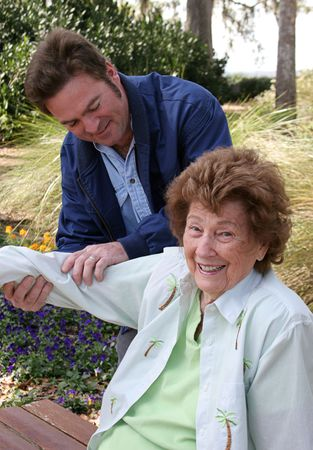 A lovely senior woman enjoying her physical therapy in a garden setting. photo