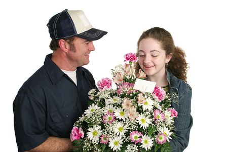 A cute teen girl receiving flowers unexpectedly. Isolated. photo