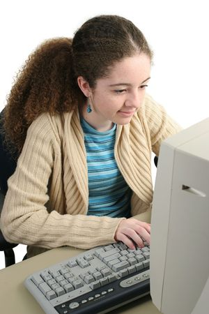 teenaged: A school girl surfing the web or doing homework online. Stock Photo