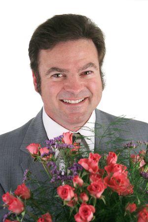 A headshot de un apuesto hombre de negocios la celebraci�n de un ramo de rosas para su esposa, novia, secretario.  Foto de archivo - 356149