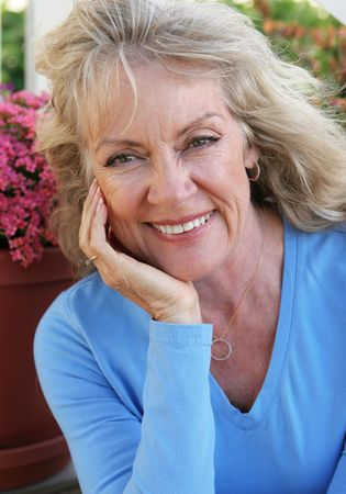 A portrait of a beautiful mature blond woman smiling. Stock Photo - 359739