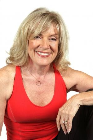 Een mooie, geschikt vijftig jaar oude vrouw in workout kleren. Stockfoto