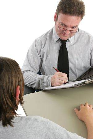 juvenile delinquent: A guidance counselor taking a case history of a student and looking skeptical. Stock Photo