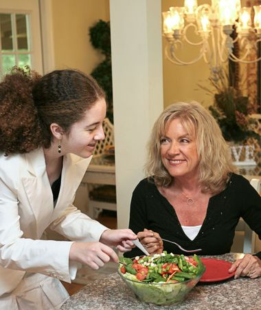 roughage: A mother and daughter sharing a healthy salad together. Stock Photo