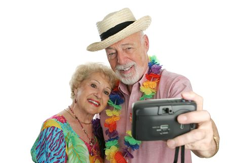 An attractive senior couple taking their picture on vacation. Stock Photo - 388981