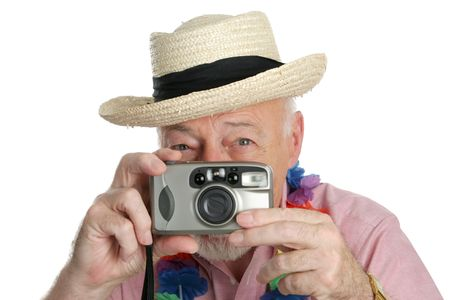 A senior man on vacation snaping photographs. Imagens