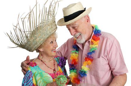 An attractive senior couple on a tropical vacation. Isolated. Stock Photo - 388969