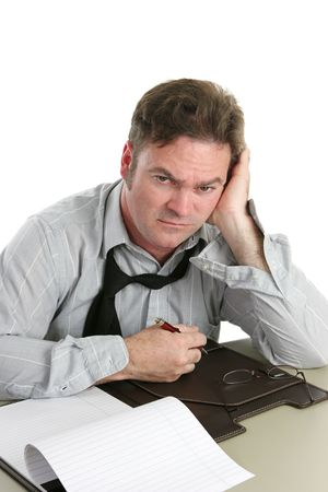 taking inventory: A tired, unhappy looking office worker after a hard day. Stock Photo