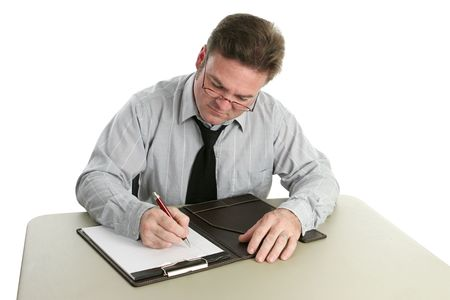 legal pad: An auditor taking notes on a legal pad. Stock Photo