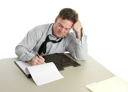 prosecutor: An office worker concentrating and taking notes. Stock Photo