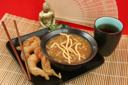 A delicious Chinese dinner of hot & sour soup, fried shrimp and tea. Stock Photo - 400184