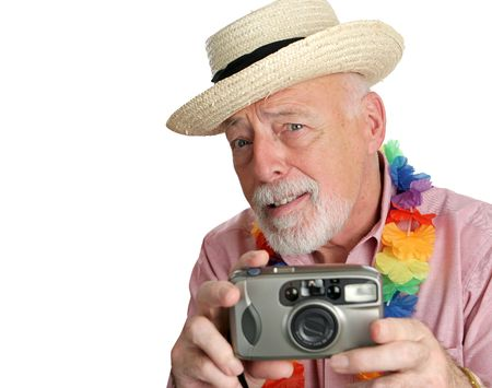 A curious senior man using his camera on vacation. photo