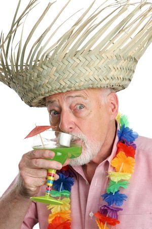 maturity: A senior man on a tropical vacation drinking a margarita with a surprised expression.  Isolated.