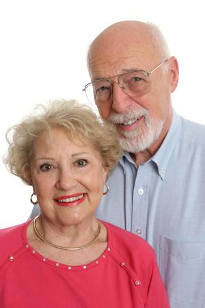 An attractive senior couple against a white background.  Vertical orientation. Stock Photo - 414209
