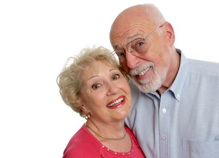 A happy senior couple who is young at . Isolated with room for text. Stock Photo - 414201