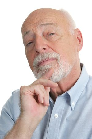 busy beard: A handsome senior man with a skeptical expression. Stock Photo
