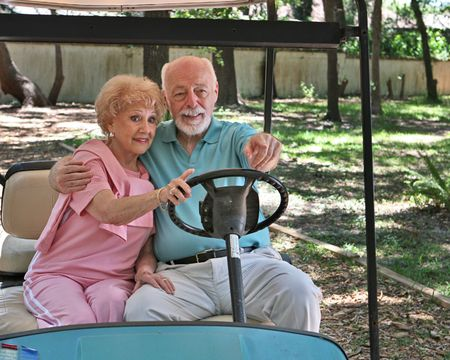 An active senior couple sightseeing in a golf cart.  Horizontal with room for text Stock Photo - 418721