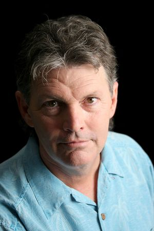 A middle-aged man suffering from depression. Dramatic lighting over black background.