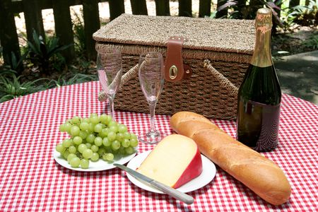 A table in the park set with a picnic for two. photo