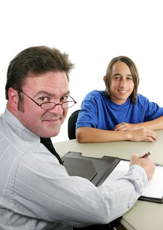 A school counselor and student at an assesment meeting. photo
