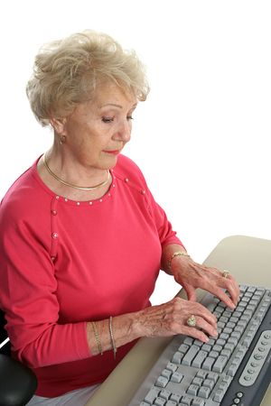 A senior lady learning how to use the computer. photo