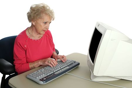A senior lady confused by the computer.  Screen intentionally blank ready for content. photo