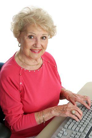 surf shop: A beautiful senior woman using the computer.