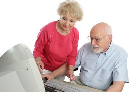 An a attractive senior couple using the computer together photo