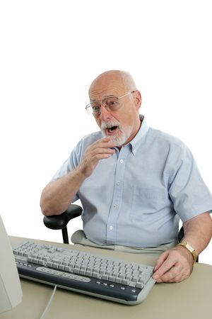 A senior man shocked by something he has seen online. Stok Fotoğraf