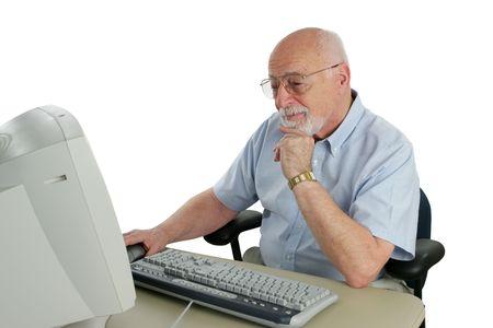 An intelligent senior man doing research online.