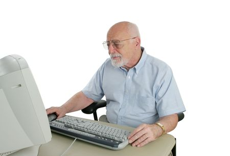 A a senior man learning the computer with an expression of concentration of confusion.