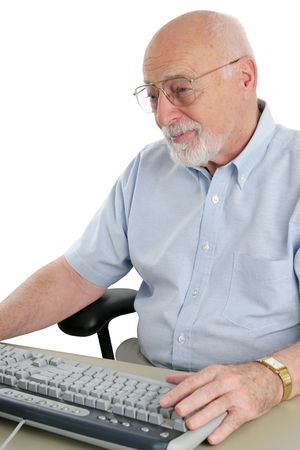 A senior man working on the computer.